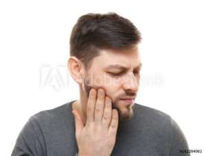 man holding face toothache
