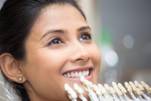 Smiling woman getting porcelain veneers in Norwalk