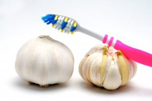 toothbrush and garlic